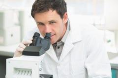 Scientific researcher using microscope in the laboratory Stock Photos