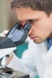 Scientific researcher using microscope in the laboratory Stock Photo