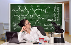 Scientific researcher woman sitting in laboratory Royalty Free Stock Photography