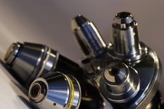 Scientific revolver (for lenses). Revolver mount with different microscope lenses Stock Photos