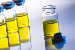 Scientific sample bottles. Four yellow scientific sample bottles royalty free stock photos
