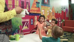 Scientific show for kids. Joyful children playing with fake snow in play center. Kids science and fun stock footage