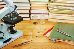 Scientific study. Microscope and books Stock Photography