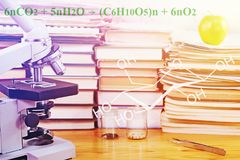 Scientific study. Microscope and test specimens of seed on the table with scientific books Stock Photo