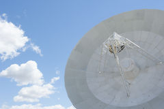 Scientific telescope dish with blue sky Royalty Free Stock Images
