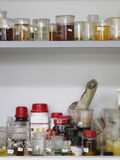 Scientific Tools With Liquid Displayed In Shelves Stock Images