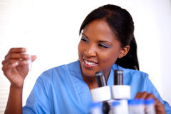 Scientific young woman looking to test tube Stock Photography