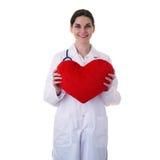 Scientifique auxiliaire de docteur féminin dans le manteau blanc au-dessus du fond d'isolement Photos stock