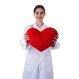 Scientifique auxiliaire de docteur féminin dans le manteau blanc au-dessus du fond d'isolement Photographie stock libre de droits