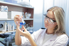 Scientist. Beauty scientist in chemical laboratory Royalty Free Stock Images
