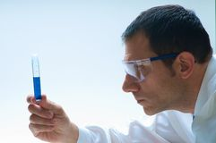 Scientist. A scientist looking at a test tube Royalty Free Stock Images