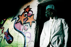 Scientist. With the gas mask in an abandoned building Stock Photos