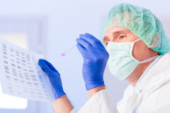 Scientist analysing DNA sequence in the lab Royalty Free Stock Images