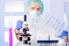 Scientist analysing DNA sequence in the lab Stock Image