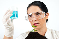Scientist  analysing  or examine liquid. Scientist woman holding a jar with blue chemicals and having a surprised face,check also my collection Scientists people Stock Photo