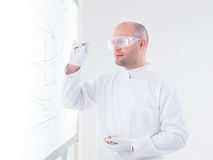 Scientist analyzing a pill Royalty Free Stock Image