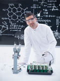 Scientist analyzing plants in lab Royalty Free Stock Images