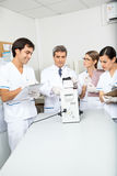 Scientist Analyzing Sample In Medical Laboratory Stock Images