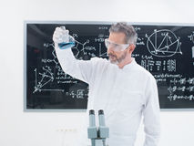 Scientist analyzing substances Royalty Free Stock Image