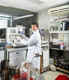 Scientist Analyzing Urine Samples In Laboratory Stock Photos
