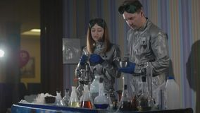 Chemists make drugs in the laboratory. stock video