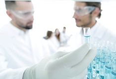 Scientist and assistant studying the solution in the tube Stock Photo