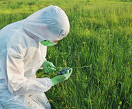 Scientist in biohazard uniform on field Royalty Free Stock Photos