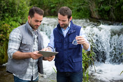 Scientist and biologist working together on water analysis Stock Photo