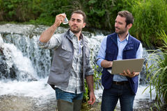Scientist and biologist working together on water analysis Royalty Free Stock Photography