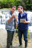 Scientist and biologist working together on water analysis Stock Image