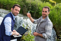 Scientist and biologist working together on water analysis Royalty Free Stock Photos