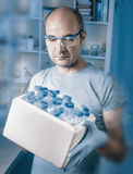 Scientist with box of samples Stock Images