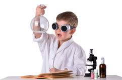 Scientist boy in black glasses holds an empty flask in his hand Stock Image