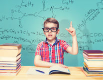 Scientist boy gets knowledge in the school library Stock Photography