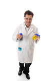 Scientist carrying lab bottles. Scientist, clinician or other laboratory worker carrying lab bottles filled with chemicals or reagents Stock Photo