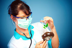 Scientist Checking Health Of A Life Royalty Free Stock Photos