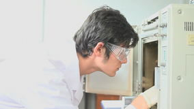 Scientist checking an incubator Stock Photo
