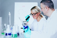 Scientist in chemical lab Stock Image