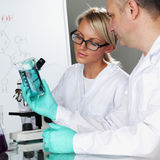 Scientist in chemical lab Stock Images
