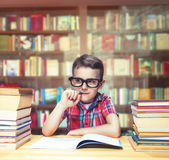 Scientist child learns homework in school library Stock Images