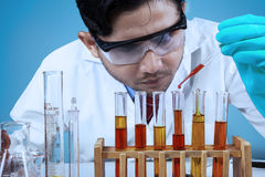 Scientist combining the chemical fluid Stock Photos