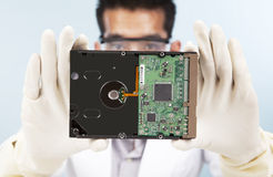 Scientist with computer hard disk Royalty Free Stock Photography