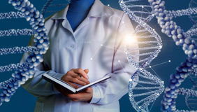 Scientist conducting research with DNA. Scientist conducting research with DNA design concept stock photo