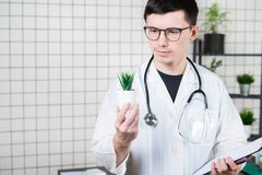 Scientist Conducts Experiments with a green Plant stock photos
