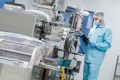 Scientist configure machine with shafts Stock Photography