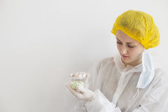 Scientist with container of pills Royalty Free Stock Photo