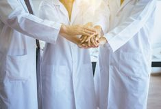 Scientists coordinate hands,Group of diversity people teamwork in laboratory,Successful and reserch working stock image
