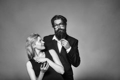 Scientist couple. Beautiful young pair. Scientist couple. Beautiful pair of pretty smiling women with mobile and bearded thoughtful handsome men in glasses Royalty Free Stock Image