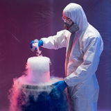 Scientist creating steaming chemical reactions Stock Image