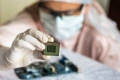 Scientist develops microchip and checking electronic circuit Royalty Free Stock Image